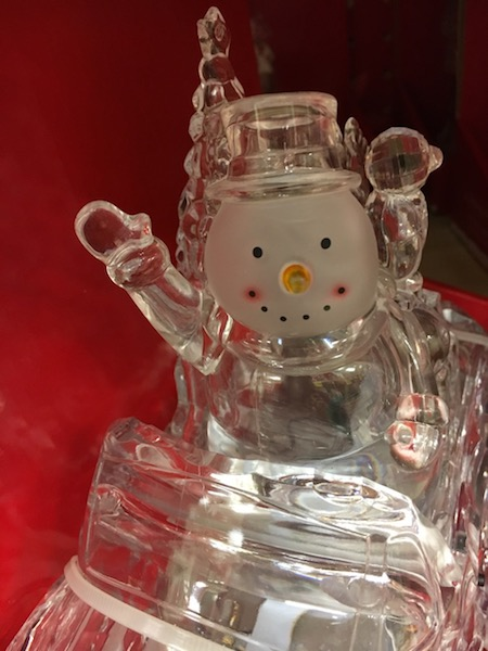 Happy snowman waving hello